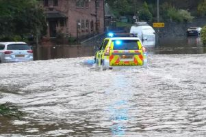 A police car negotiates floodwater in Amber Valley on Friday. Pic: Derbyshire Roads Police.