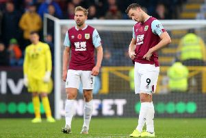 Burnley's Charlie Taylor and striker Chris Wood