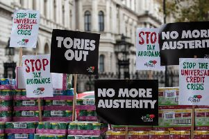 A protester stages a food bank demonstration on Whitehall complete with tons of packaged food against the Government's Universal Credit programme on November 21, 2017 in London, England. The campaign group the People's Assembly Against Austerity are staging a number of protests across the country ahead of tomorrow's Budget. (Photo by Jack Taylor/Getty Images)