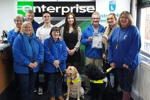 Staff at Enterprise Rent-a-car in Bamber Bridge presenting a 400 cheque in aid ofLostock Hall & Bamber Bridge Guide Dog Group.