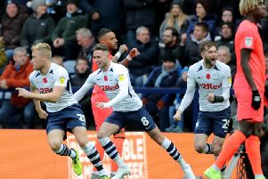 Jayden Stockley and Tom Barkhuizen celebrate Preston's first goal against Huddersfield