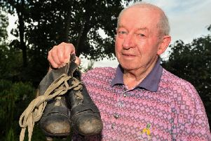 Les Campbell with the boots he wore on his Preston debut in 1953