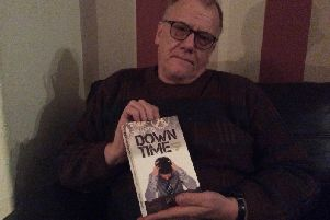 John Stopford with his book