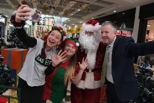 Santa with Chief Elf Charlotte Carnell, Bad Elf Emma Russ and centre manager Andrew Stringer