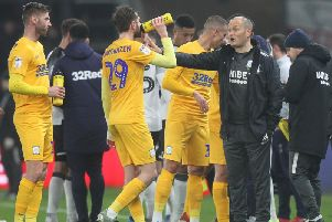Preston manager Alex Neil gives out instructions during a break in play against Derby