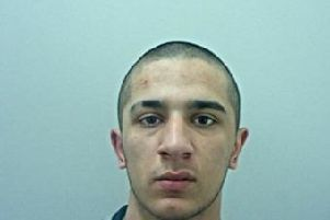 Dean Qayum, 20, is wanted in connection with the hit and run death of Alison McBlaine in Blackburn on November 19. He is believed to have a leg injury and could be using crutches. Pic: Lancashire Police