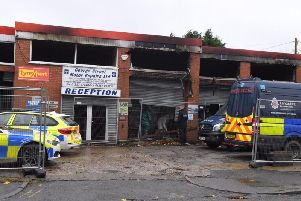 A number of police vehicles descended on George Street Motors in George Street, Chorley this morning