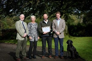 The presentation of the Royal Forestry Society's Long Service Award to Mick Dickinson who has worked at the Abbeystead Estate in Lancashire for 40 years.