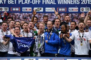 Preston North End celebrate winning promotion from League One at Wembley.
