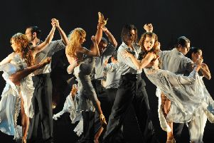 Choreographer and Argentine tango champion German Cornejo and his partner Gisela Galeassi with the cast of Tango Fire.