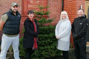 Lewis Buller, Karen Peddie, Karen Sutton and Kevan Williams, who owns the Blue Anchor, will serve Christmas dinners to older people who are lonely during the festive season.