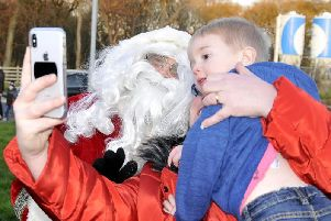 Father Christmas poses for a selfie on his Buckshaw Village Tour