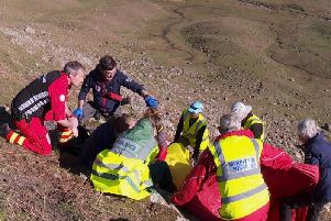 Vivienne being treated by air ambulance medics. 'Credit: Holly Taylor, Great North Air Ambulance Service