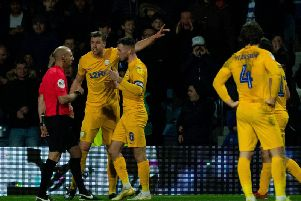 Preston's Paul Huntington and Alan Browne complain to referee Andy Davies about the award of the penalty for QPR's second goal