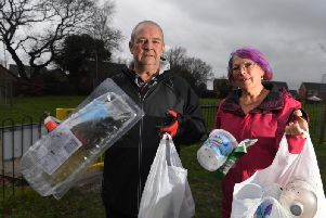 Mick and April with some of the rubbish they have collected