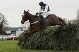 Walk In The Mill clears the last in the Becher Chase under James Best.