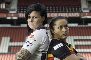 Featherstone's Woman's captain Natalie Harrowell, pictured with Bradford Bulls' captain Kirsty Moroney. Picture: Allan McKenzie/SWpix.com