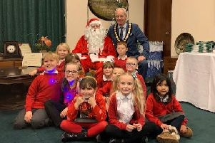 Children from Butler's Hill School at the lights switch-on with the council chairman, Coun Kevin Rostance, and Santa.