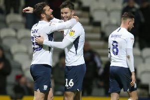 David Nugent gets a hug from Andrew Hughes after scoring Preston's second goal against Fulham at Deepdale