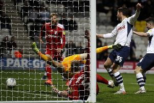 Preston North End's David Nugent scores against Fulham