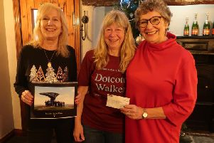 Lancashire Dotcom walkers  Jean Fairclough, Jill Greenhalgh and Lesley Davies sold copies of their calendar and presented a cheque to St Catherines Hospice