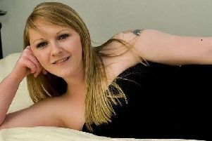 Pauline Flett, 34, who is nicknamed Batgirl because of a tattoo on her arm, is wanted by police following a number of alleged frauds in Scotland and Lancashire. Pic: Police Scotland