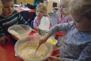 Pre-school children at the Stepping Stones Nursery in Mirfield make buns for a treat after tea.