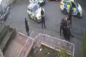 CCTV footage appears to show a police officer punching a 34-year-old man who was being detained in Accrington.