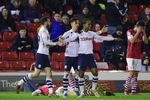 Daniel Johnson celebrates scoring Preston's goal with Tom Barkhuizen and Josh Harrop