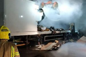 Firefighters tackle a trailer fire off Millennium Road, Preston