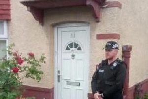 A police officer outside the home Steven May and Darren Taylor shared at 31 Raven Street, Deepdale, Preston on May 20, 2019
