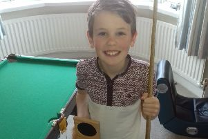 Ben Walsh with Ronnie O'Sullivan's medal