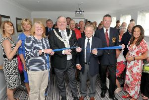 Mayor Stuart Carefoot and President Roger Cain cut the ribbon at the official opening of new male and female changing rooms and conference room at Longridge Golf Club. Photos by David Hurst.