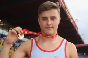 Sam Gaskell with his gold medal