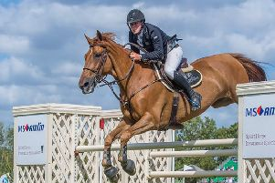 James Whitaker on his way to winning Hickstead's Queen Elizabeth II Cup (Picture: Julian Portch).