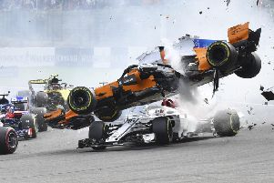 CRASH: McLaren driver Fernando Alonso goes over the top of Sauber's Charles Leclerc at the start of the Belgian Grand Prix in Spa-Francorchamps. Picture: AP/Geert Vanden Wijngaert