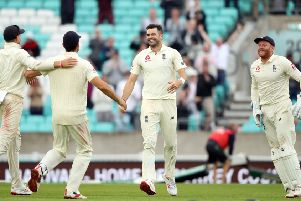England's James Anderson celebrates taking his 564th wicket