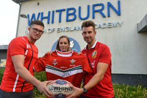 Former Whitburn C of E Academy pupil and Wales rugby player James McGurk donates his signed shirt to head of year Charlotte Rush and head of PE James Leggett (R)