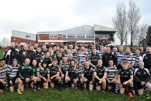 Wigan RUFC and Wigan St Patrick's took part in the inaugural Ronnie Dutch Memorial Match in memory of a legend of both clubs. The two teams before kick-off.  Pictures: Rob Lock