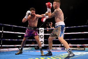 Scott Fitzgerald (left) in action against Craig Morris during their super-welterweight contest at the Birmingham Arena