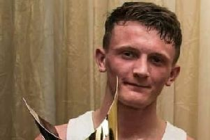 Tom Bell, pictured holding the Ken Blood trophy. The award, named after Doncaster Plant Works Amateur Boxing Club's former coach, is handed to the gym's boxer of the year. Picture: Doncaster Plant Works ABC