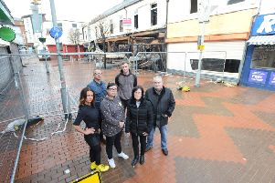 Blandford Street traders in need of answers following Peacocks fire. From left Ashley Dembry, Jonathan Pickup, Blanch Shek, Peter Whale,  Liz Riley and Ken Craigs.