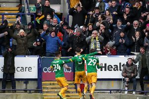 Alan Browne celebrates scoring Preston's opening goal with the travelling support