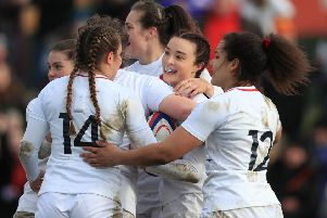 England's women celebrate after Kelly Smith's try against France at Doncaster.
