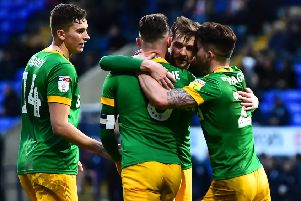Tom Barkhuizen is congratulated by Jordan storey, Alan Browne and Sean Maguire after scoring the winning goal against Bolton