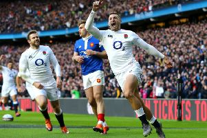 England's Jonny May celebrates scoring is team's first try of the game at Twickenham. Picture: Gareth Fuller/PA