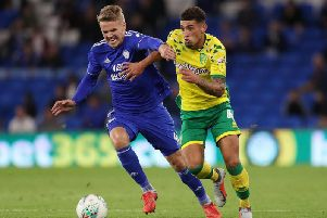 Norwich City's Ben Godfrey and Cardiff City's Danny Ward battle for the ball