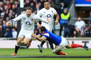 England's Elliot Daly (left) in action during the Guinness Six Nations match at Twickenham Stadium, London. (Picture: Gareth Fuller/PA Wire)