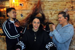 Aimee Stewart (centre) at Blak Bear barbering in York with barbers Bryan David and Manager Rosie Williamson.