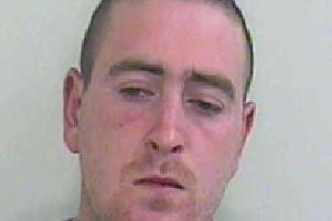 Stuart Taylor, 35, is wanted by police in connection with a robbery in Samuel Street, Preston on January 13.